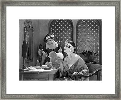 Deco Woman Puts On Makeup Framed Print by Underwood Archives