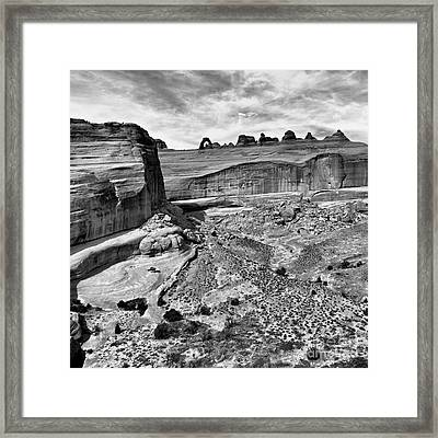 Delicate Arch In The Distance In Monochrome - Arches National Park - Moab Utah Framed Print by Silvio Ligutti