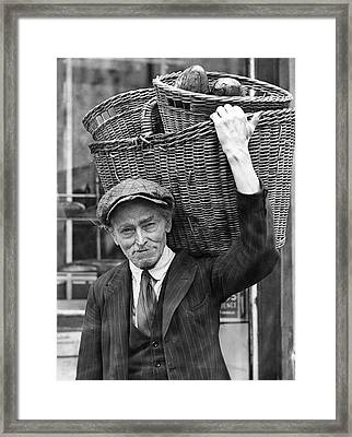 Delivering Baskets Of Bread Framed Print by Underwood Archives