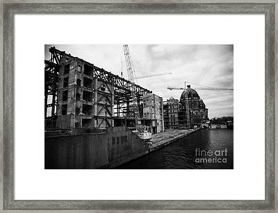 demolition of the Palast der Republik on the bank of the river Spree with the Berliner Dom in the background Berlin Germany Framed Print by Joe Fox