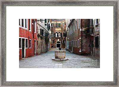 Deserted Street Framed Print by John Rizzuto