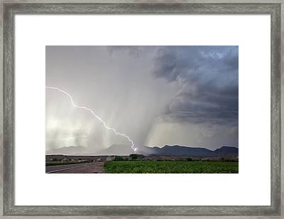 Diagonal Lightning Strike Framed Print by Roger Hill