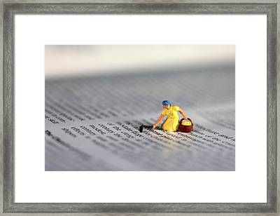 Digging The Knowledge In Books Framed Print by Paul Ge