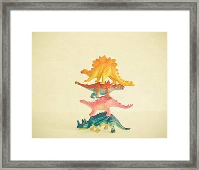 Dinosaur Antics Framed Print by Cassia Beck