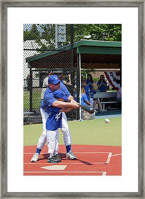 Disabled Boy Playing Baseball Framed Print by Jim West
