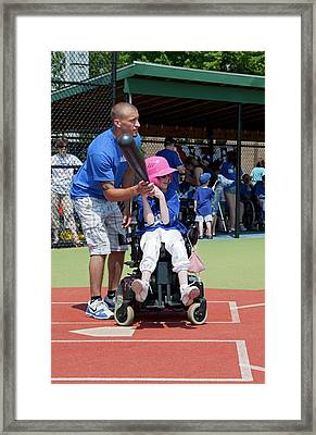 Disabled Girl Playing Baseball Framed Print by Jim West