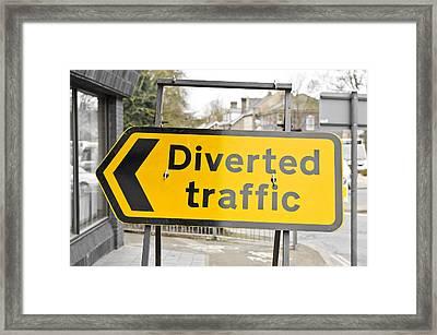 Diverted Traffic Framed Print by Tom Gowanlock