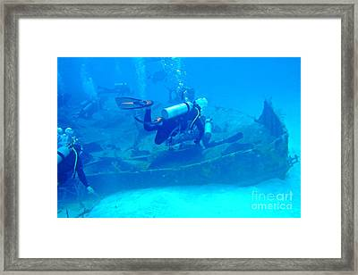 Diving The James Bond Movie Wreaks Framed Print by John Malone