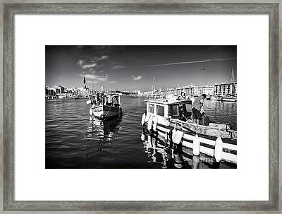 Docking At The Market Framed Print by John Rizzuto