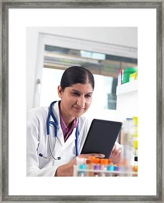 Doctor Using A Digital Tablet Framed Print by Tek Image