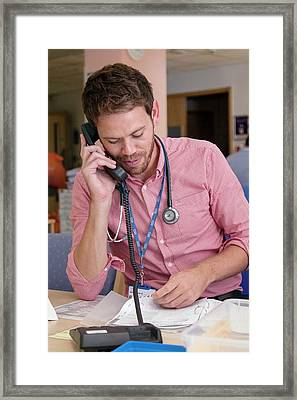Doctor Using A Phone Framed Print by Life In View