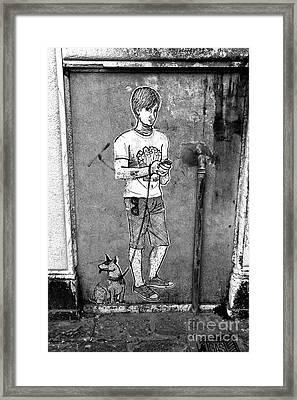 Dog Walker In Venice Framed Print by John Rizzuto
