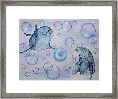 Dolphins Playing With Bubbles Framed Print by Remrov Vormer