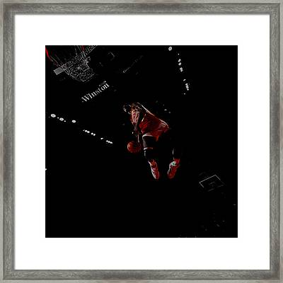 Dominique Wilkins Took Flight Framed Print by Brian Reaves