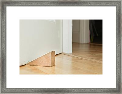 Door Stopper Framed Print by Tom Gowanlock