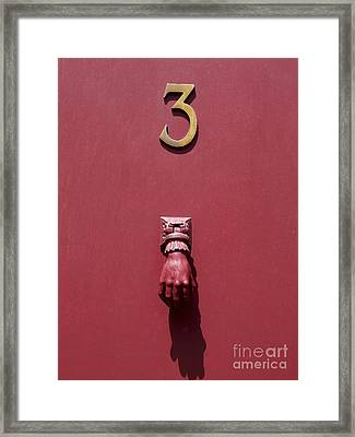 Doorknocker And Number Three On A Red Door. France. Europe. Framed Print by Bernard Jaubert