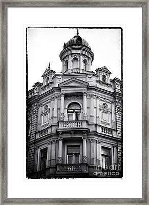 Double Balconies In Prague Framed Print by John Rizzuto