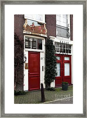 Double Dutch Red Framed Print by John Rizzuto