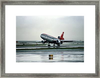 Douglas Dc-10-40 Taking Off In The Rain Framed Print by Wernher Krutein
