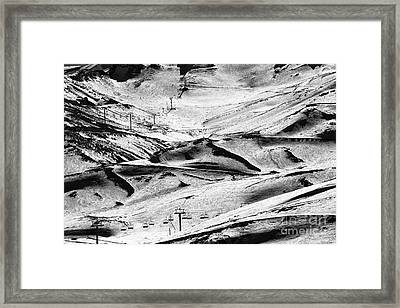 Down The Slope Framed Print by John Rizzuto