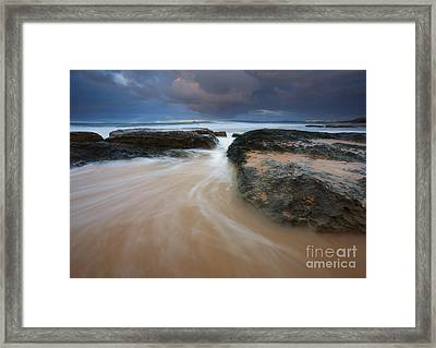 Driven Between The Rocks Framed Print by Mike Dawson