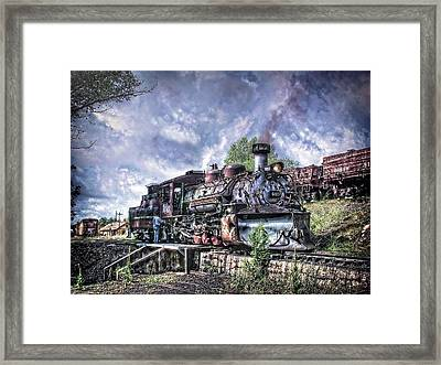 Dropping The Ash Framed Print by Ken Smith