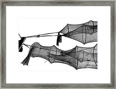 Drying Fishing Trap Nets On Poles Framed Print by Niels Quist