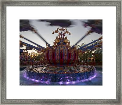Dumbo The Flying Elephant Ride At Dusk Framed Print by Adam Romanowicz