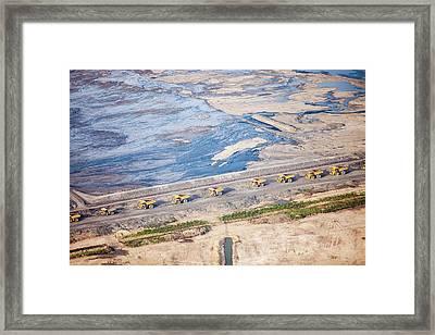 Dump Trucks At Tar Sand Mine Framed Print by Ashley Cooper