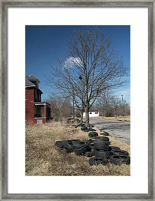 Dumped Vehicle Tyres Framed Print by Jim West