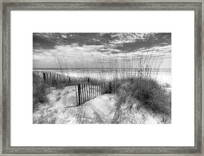 Dune Fences Framed Print by Debra and Dave Vanderlaan