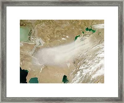 Dust Storm Over The Aral Sea Framed Print by Nasa/jeff Schmaltz