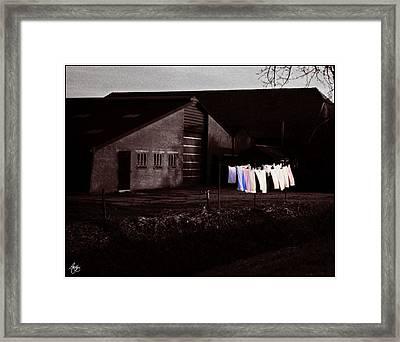 Dutch Incongruities At Dusk Framed Print by Wayne King