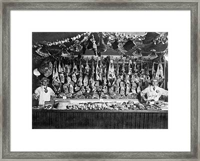 Early Butcher Shop Framed Print by Underwood Archives