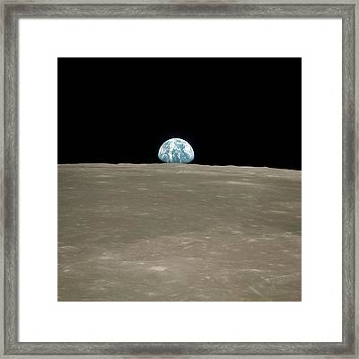 Earthrise Over Moon Framed Print by Nasa