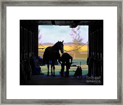 East Door Farrier Framed Print by Judy Wood