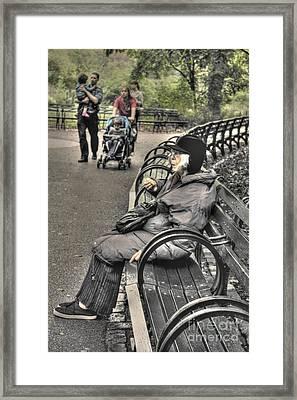 Eating Alone In Central Park Framed Print by David Bearden