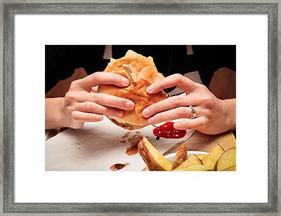Eating Burger Framed Print by Tom Gowanlock