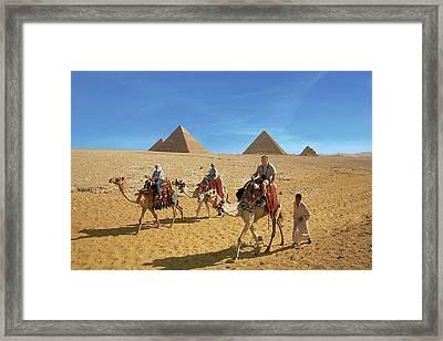 Egypt, Cairo, Giza, Tourists Ride Framed Print by Miva Stock