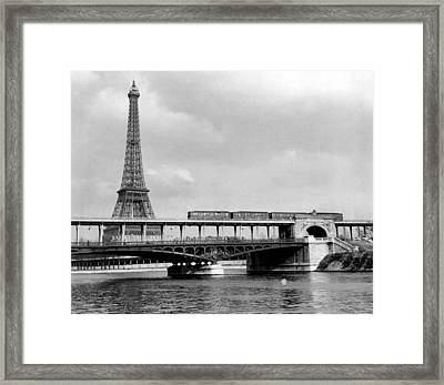 Eiffel Tower Behind Bridge. Framed Print by Retro Images Archive