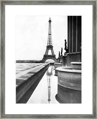 Eiffel Tower Reflection Framed Print by Underwood Archives