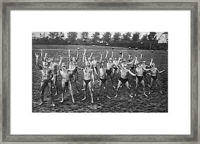 Eighteen Men Tossing Balls Framed Print by Underwood Archives