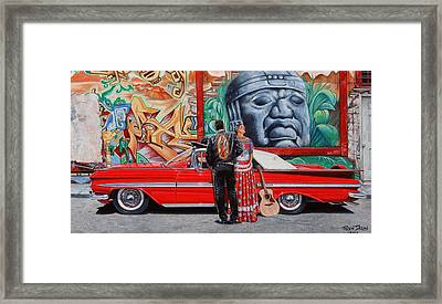 El Mariachi Y La Danzante Framed Print by Ruben Duran