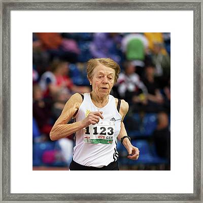 Elderly Female Athlete In Competition Framed Print by Alex Rotas