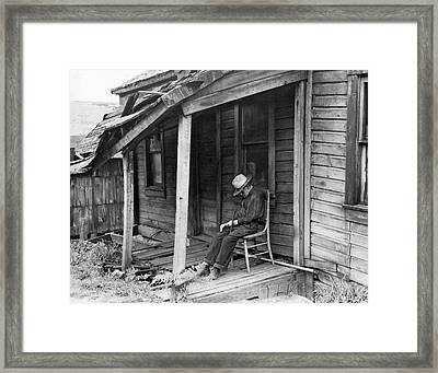 Elderly Man Doses On His Porch Framed Print by Underwood Archives