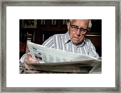 Elderly Man Reading A Newspaper Framed Print by Mauro Fermariello