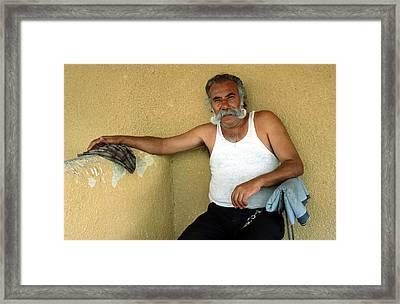 Elderly Man Relaxing Framed Print by Mark Goebel