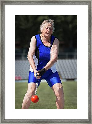 Elderly Woman Competitive Weights Thrower Framed Print by Alex Rotas