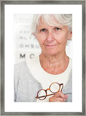 Elderly Woman Holding Glasses Framed Print by Lea Paterson