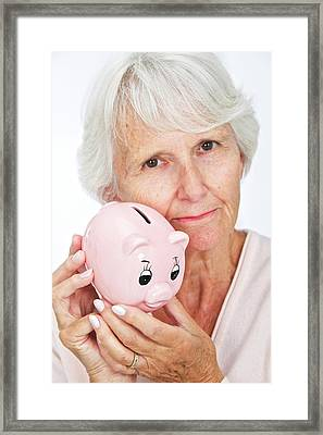 Elderly Woman With A Piggy Bank Framed Print by Lea Paterson